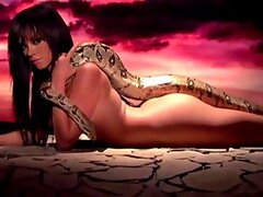 Valerie Mason gets naked with a huge snake