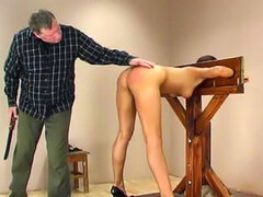 Sweet girl in the stockades spanked hard