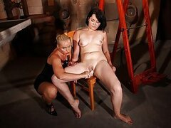 Domina Kathia is here again to train her new victim to obedience. Slave Adelaida is tied tightly to a ladder, arms and legs akimbo. Just the perfect position to break any kind of physical or psychological resistance! And that's exactly what Domina Dora is