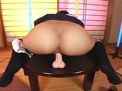 Japanese girl riding toy with her wet cunt