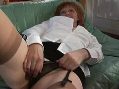Redhead Granny loves giving her stud a rim job