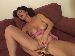 Brunette hot granny fucks herself in a hotel room. Homemade video.