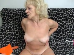 Granny strips nude and plays with her pussy
