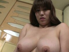 Crummy japanese slut Kumi Shibahara squeezes her big boobs and stretches her pink pussy lips