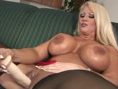 Lustful blonde with huge boobs toys herself with big dildo